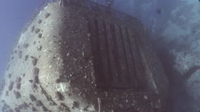Ship wreck Salem Express underwater in the Red Sea in Egypt. Extreme tourism on ocean floor in world of coral reefs, fish, sharks. Researchers of wildlife blue stock footage