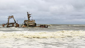 Ship Wreck in Skeleton Coast, Namibia. A ship wreck in the Skeleton Coast, Namibia. The Skeleton Coast is the northern part of the Atlantic Ocean coast of royalty free stock image