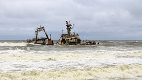 Ship Wreck in Skeleton Coast, Namibia. A ship wreck in the Skeleton Coast, Namibia. The Skeleton Coast is the northern part of the Atlantic Ocean coast of stock image