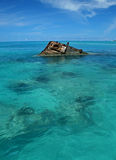 Ship Wreck in a Tropical Sea. One end of a ship wreck (the Vixen) coming out of a tropical Sea in Bermuda Royalty Free Stock Image