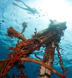 Ship wreck. Underwater shot of the ship wreck with snorkeler's silhouette on the surface Royalty Free Stock Photography