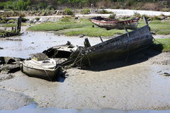 Ship wrecks falling dry at low tide in Noirmoutier Royalty Free Stock Image