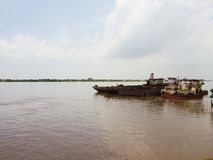 Ship wrecks at Mekong river. Wrecks on the bank of the Mekong river in Cambodia Stock Images