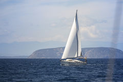 Ship yacht with white sails in the Sea Royalty Free Stock Images