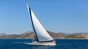 Ship yachts with white sails in the open Sea. Royalty Free Stock Image