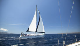 Ship yachts with white sails in the open Sea. Stock Photography