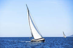 Ship yachts with white sails in the open Sea. Luxury boats. Stock Photography