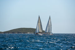Ship yachts with white sails in the open Sea. Luxury boats. Royalty Free Stock Images