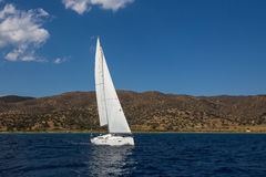 Ship yachts with white sails in the open Sea. Stock Photo