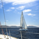 Ship yachts with white sails in the open Sea. Sailing. Royalty Free Stock Photos
