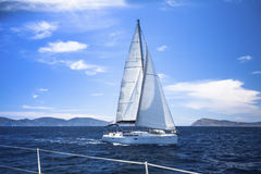 Ship yachts with white sails in the Sea. Luxury boats. Stock Photos