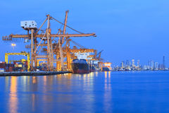 Ship yard with heavy crane in beautiful twilight of day. Use for import export industry and international trading Royalty Free Stock Image