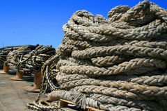 Ship Yard Ropes. Row of ship yard ropes over blue sky Stock Photography