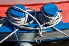 Shipboard bollard. Shipboard bitt with nylon rope Stock Images