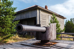 Shipboard gun on island Mudju Stock Photos