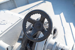 Shipboard Valve. Close up detailed view of a metal valve at an open deck of a ship Royalty Free Stock Photography