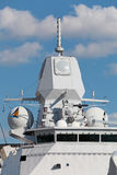 Shipborne radar. Antenna of the radar and other equipment on the deck of a modern military ship Royalty Free Stock Photos