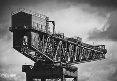Shipbuilding Crane In Glasgow. Black And White Image Of Industrial Shipbuilding Crane On The Clyde River In Glasgow Stock Photo