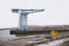Shipbuilding crane at harbour harbor port for construction of vessels in dock titan clydebank govan glasgow Scotland uk. Traditional industry Stock Photos