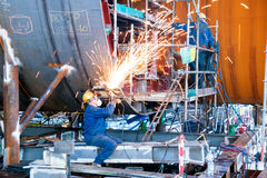 Shipbuilding fitter. Fitter grinding welds on the construction of external ballast tanks of an oil rig Royalty Free Stock Photos