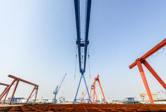 Shipbuilding gantry crane factory site. Wide-angle stock photography