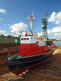 Shipbuilding, ship repair. Fire-boat in floating dry dock. Gdansk, Poland stock image
