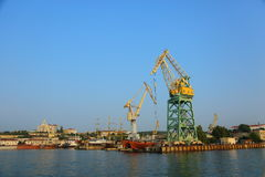 Shipbuilding and ship repair yard. Large shipyard with cranes and piers on the coast stock image