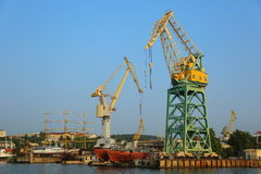 Shipbuilding and ship repair yard. Large shipyard with cranes and piers on the coast stock images