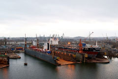 Shipbuilding view. View of the repaired vessels at the docks in the Gdansk shipyards Repair Stock Photo