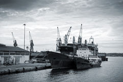 Shipbuilding zone. Black & white photo of cargo vessels docked at the shipbuilding zone Stock Photo