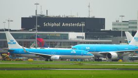 Shiphol airport traffic. Amsterdam, The Netherlands - July 25, 2017: KLM Royal Dutch Airlines Boeing 777 PH-BQM towing to service, and KLM Boeing 737 PH-BXL stock video