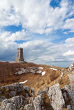 Shipka monument in early spring. The memorial war on Shipka pass is a tower stone 32 m. high in the form of a truncated pyramid builded to those who died for the Stock Photos