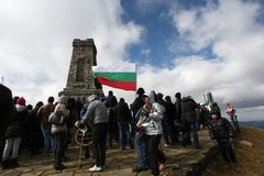 Shipka peak monument - a symbol of the liberation of Bulgaria. March 3 is the National Day of Bulgaria. Shipka peak, Bulgaria - March 3, 2015: People in the Royalty Free Stock Photo