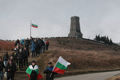 Shipka peak monument - a symbol of the liberation of Bulgaria. March 3 is the National Day of Bulgaria. Shipka peak, Bulgaria - March 3, 2016: People in the Royalty Free Stock Photography
