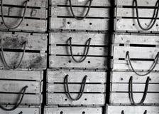Shiplap askar som staplas i raster arkivbild