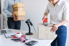 Shipment Online Sales, Small business or SME entrepreneur owner delivery service and working packing box, business owner working royalty free stock photo