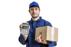 Shipment and package delivery concept. Young man holds cardboard box and payment terminal. Stock Photos