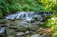 Shipot waterfall on a mountain river among stones and rocks in the Ukrainian Carpathians Stock Image