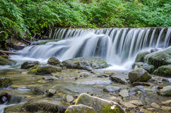 Shipot waterfall on a mountain river among stones and rocks in the Ukrainian Carpathians Royalty Free Stock Image