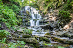 Shipot waterfall on a mountain river among stones and rocks in the Ukrainian Carpathians Stock Images