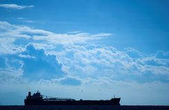 Shipping. Container ship against a cloudy sky Royalty Free Stock Images