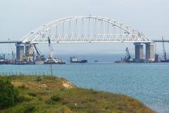 Shipping arch span Crimean bridge across the Kerch Strait. Fairway royalty free stock photos