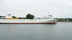 Shipping boat navigating along the coast stock footage