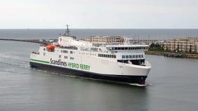 Shipping boat navigating coast stock video footage
