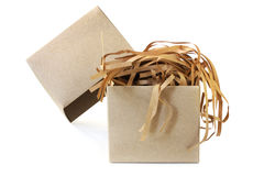 Shipping Box. Brown cardboard shipping box, filled with shredded paper packing material.  Isolated on white with soft shadow Stock Photography