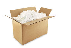 Shipping Box. Cardboard shipping box filled with styrofoam peanuts, isolated on white Royalty Free Stock Image