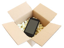 Shipping box with black smartphone Stock Image