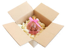 Shipping box with pink perfume bottle Stock Image