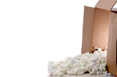 A shipping box spilling peanuts Royalty Free Stock Photography