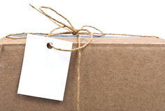 Shipping box with tag Royalty Free Stock Image